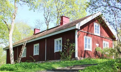 "The countryside hotel ""Svartå Manor"" near the City of Raseborg in the South of Finland consists of five different historical buildings situated in an idyllic park with a scenic river flowing nearby."